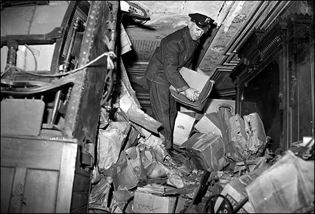 In 1947, a policeman sifts through rubble in the Collyer mansion. (Photos By Tom Watson -- New York Daily News)